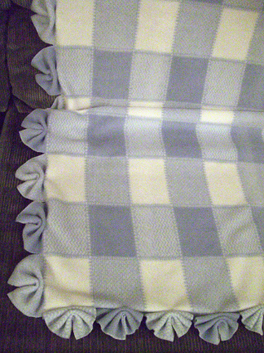This fan-fold edging is an easy way to finish off a baby blanket.