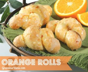 These orange rolls are the easiest ever to make. Use frozen rolls, thaw, tie into a knot shape, dip in butter and then an orange/sugar mixture, and bake.