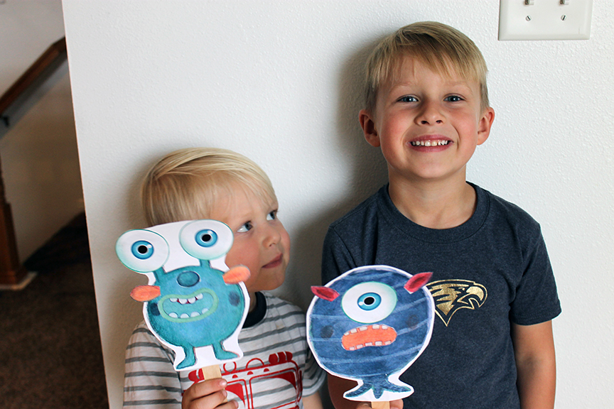 Kids enjoy making these simple monster puppets with free printables.