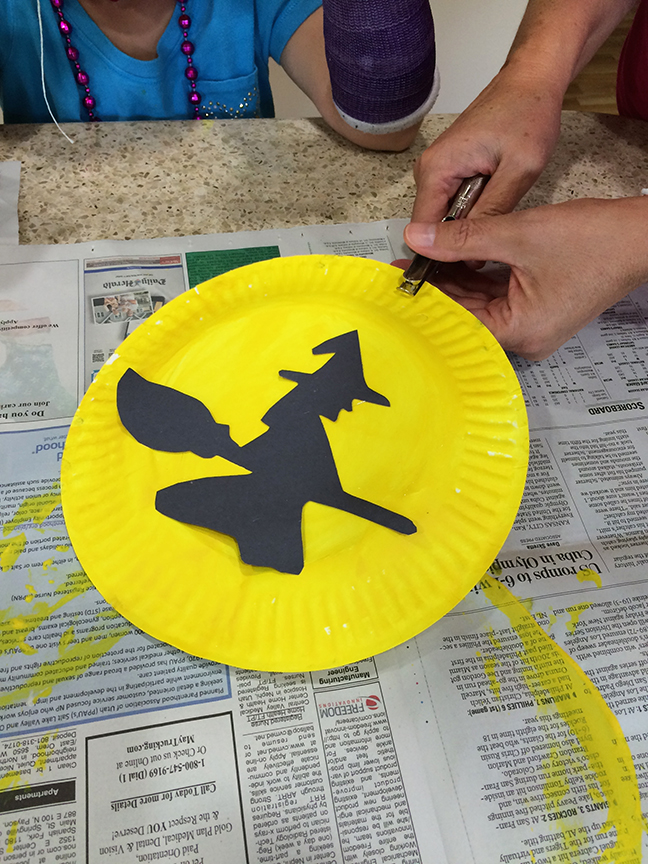 Kids love making these Halloween silhouettes. They are so simple to do. Free printable for the silhouettes.