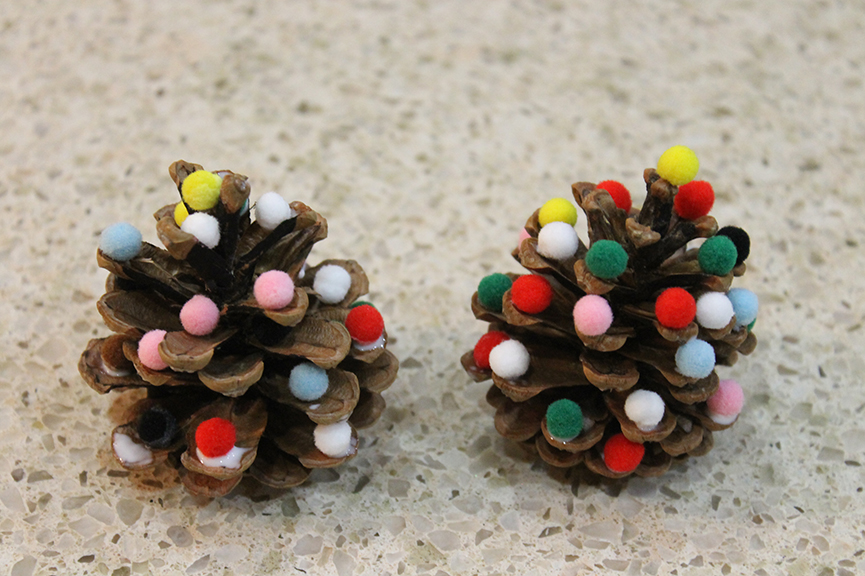 These pine cone Christmas trees are one of the easiest Christmas crafts for kids!