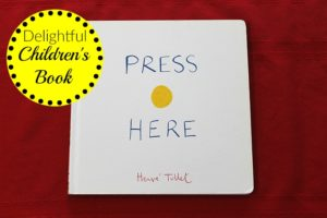 The children's picture book Press Here by Herve Tullet is one of the most delightful children's books around! You've GOT to read it to your kids!