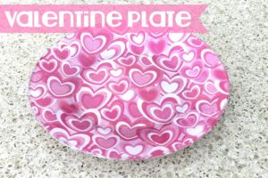 Wow! Make this washable Valentine plate with scrapbook paper by using dishwasher safe Mod Podge!