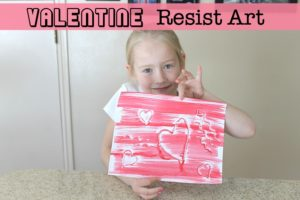 Make a Valentine resist art drawing using a hot glue gun and paint.