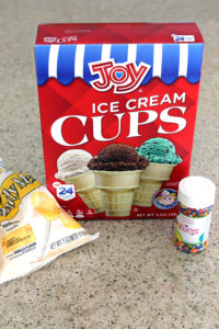 Jazz up ice cream cones by dipping them in melted colorful candy melts and dipping them in sprinkles. Kids go wild over them!