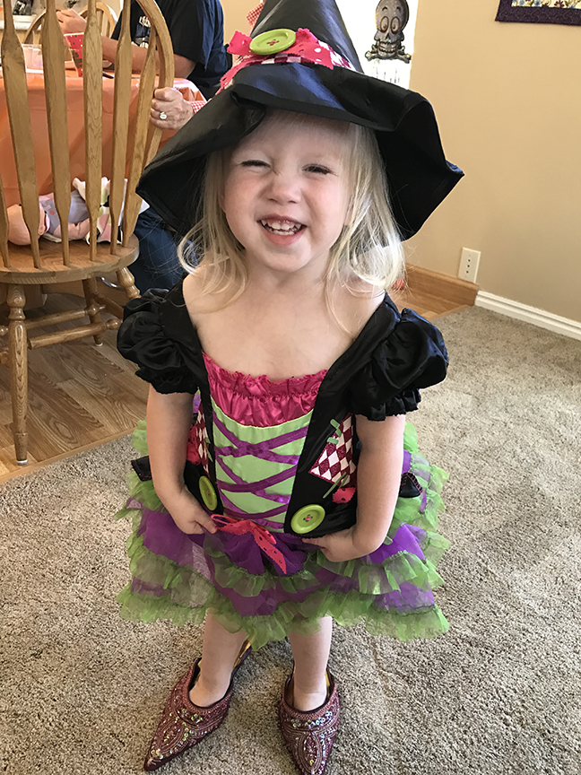 My granddaughter shows off her Halloween costuem.
