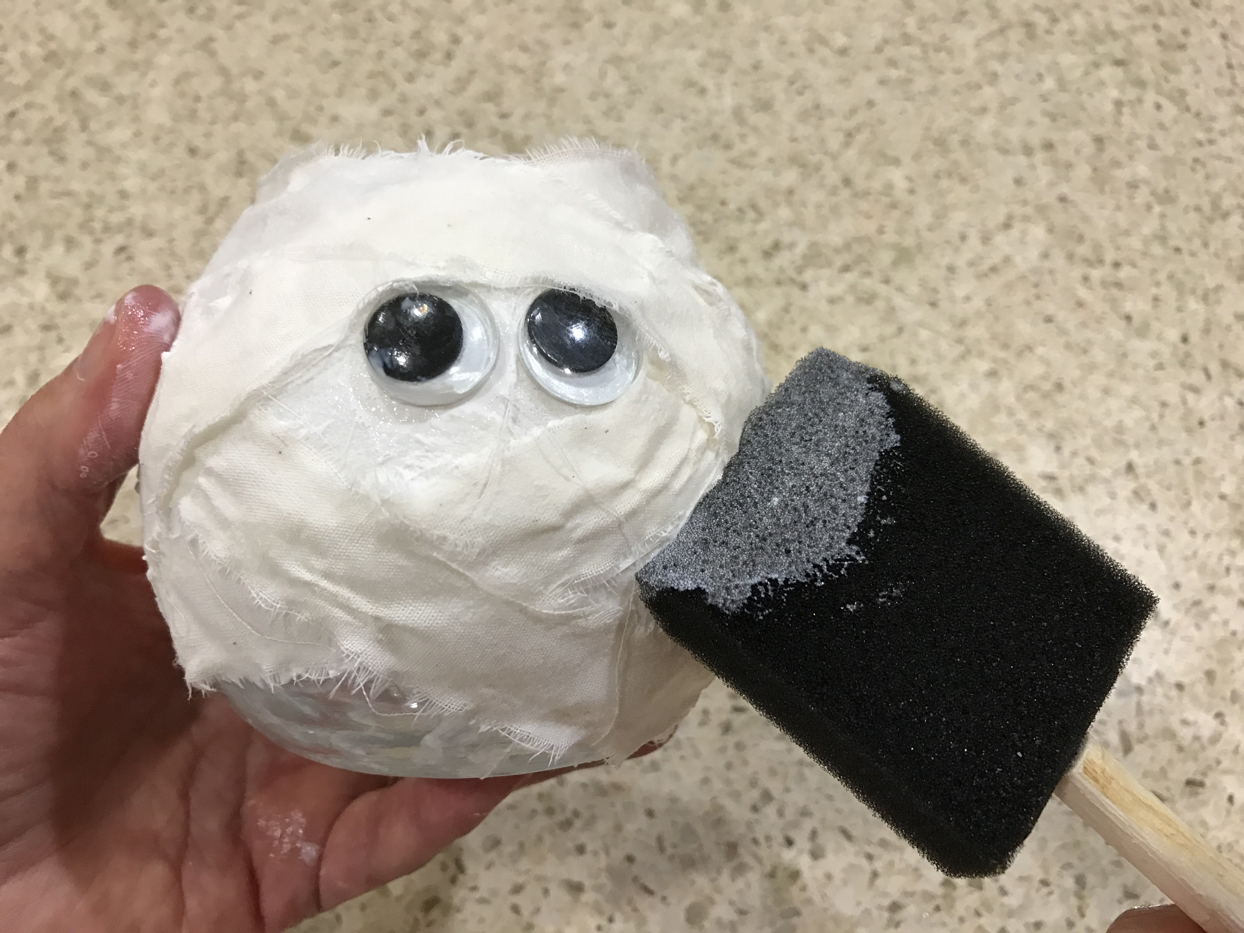 This mummy craft is super easy to make. Just Mod Podge and scrap material and googly eyes.