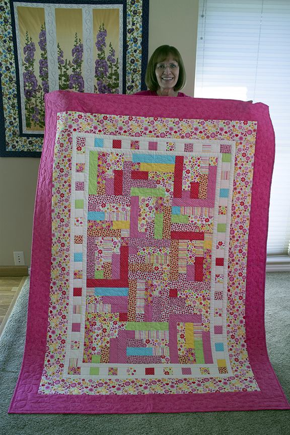 I made these quilts for my grandkids doing a free-style design on a long-arm quilting machine.