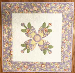 This is a wall hanging that I quilted with my long arm quilting machine.