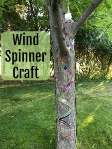 Make this easy craft of a wind spinner out of a plastic water bottle, marking pens, and some string.