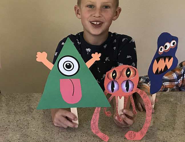 A monster on a stick is an easy Halloween craft for kids to do.